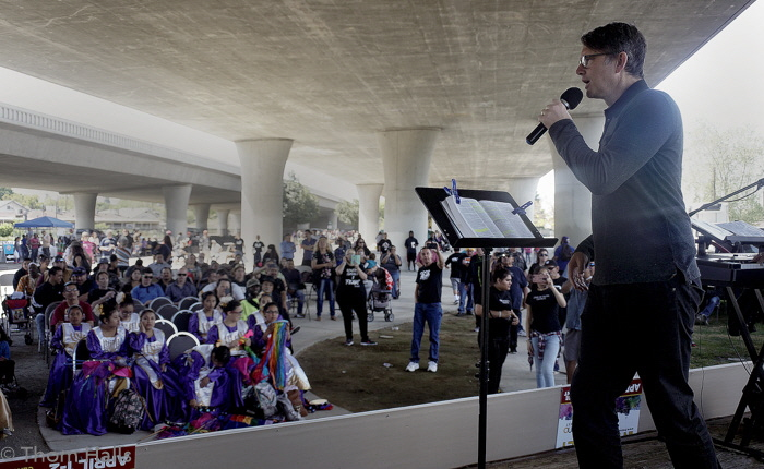 Evangelist Andrew Palau preaches at the small park underneath the freeway near downtown Fresno.