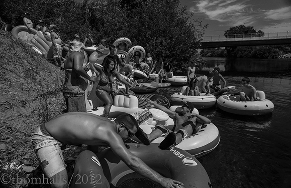 Fourth of July, Goodfellow Bridge, Sanger, California - . A hord of floaters launch into the river to spend a hot day floating between Sanger and Reedley, California.  Residents along the river do not like the influx, but must tolerate it.