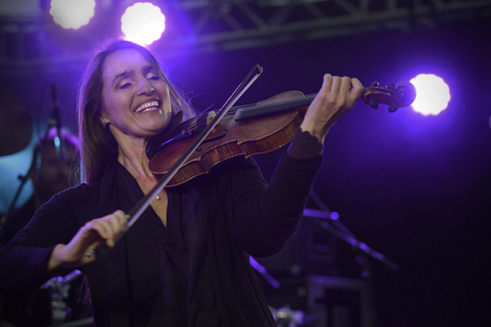 Violinist Susanne Lundeng, (Norway) shows the joy of music as she performs on the second stage venue during the Festival. A packed room listened to her stringed folk music renditions.